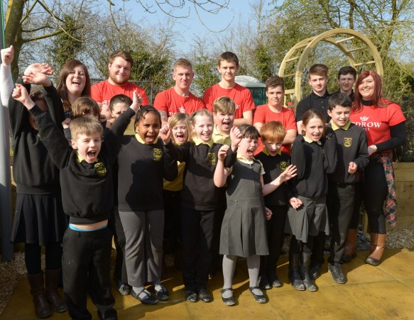 Redrow's team of apprentices with pupils from Ann Edwards Primary School...